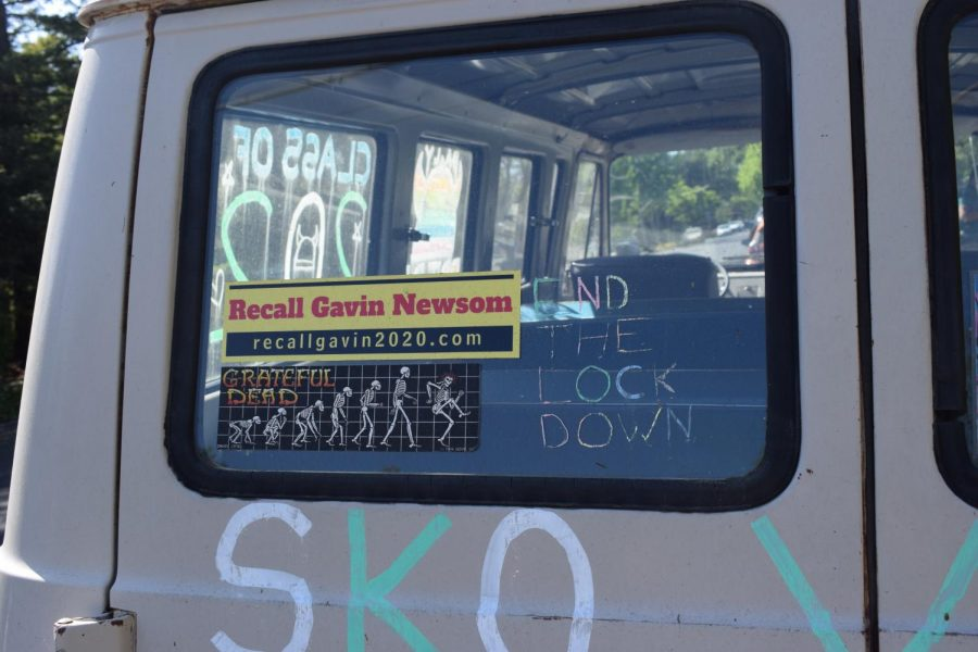 """VAN VIEWPOINT. A bumper sticker that declares """"Recall Gavin Newsom"""" is displayed on the van of a Palo High School student. Photo by Anya Lassila."""