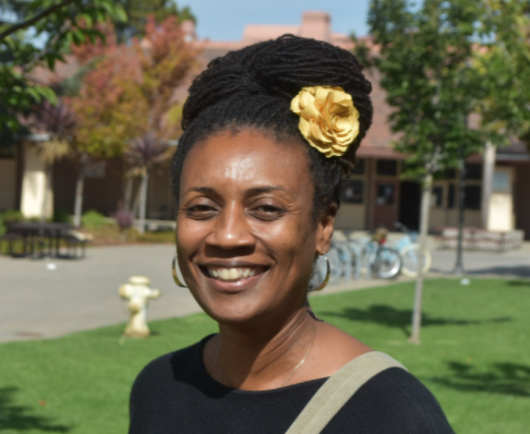 LaDonna Butler smiles for a photo outside of her office at Palo Alto High School. Photo by Daniel Garepis-Holland.